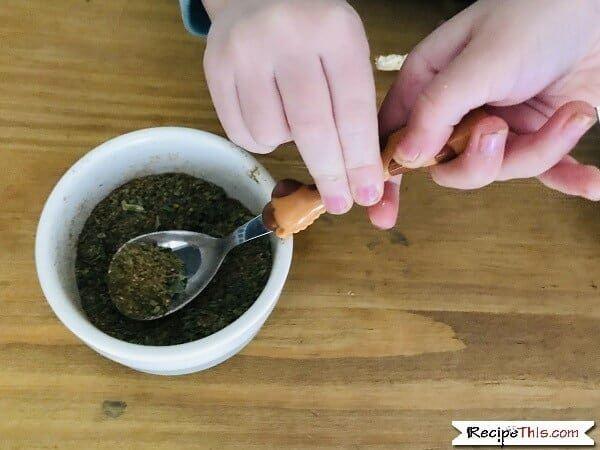 Kids mixing cuban fried rice seasoning