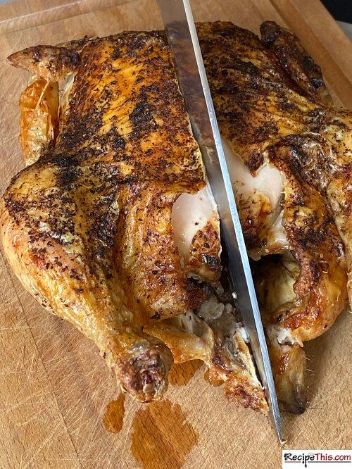 chopping piri piri whole chicken down the middle